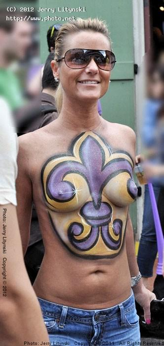 In The French Quarter One Lady Shows Her Body Painting To The