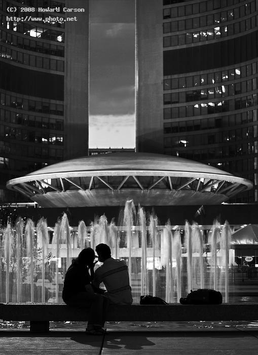 a couple watching the spaceship nathan philips s set square futuristic toronto city hall domed coun carson howard