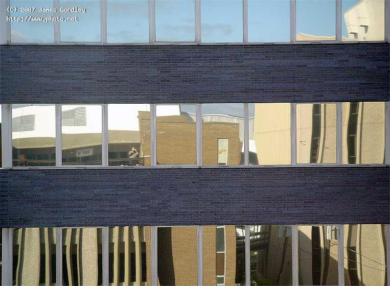 abstract self portrait reflected buildings and sky gordley james