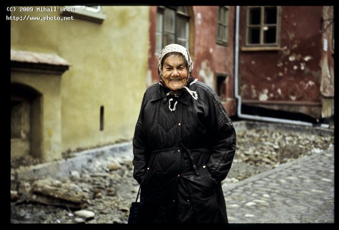 an old local of the medieval town sighisoara ro seeking critique ursu mihail