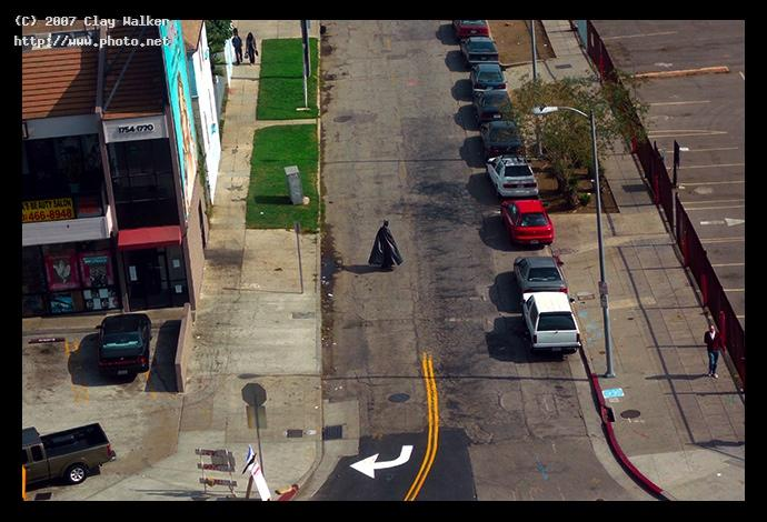 batman walks down the street walker clay