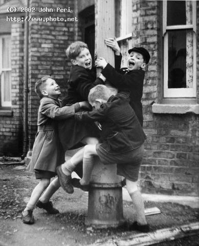boys on a lampost an older picture published in p ilford fp children johnperi photos le peri john