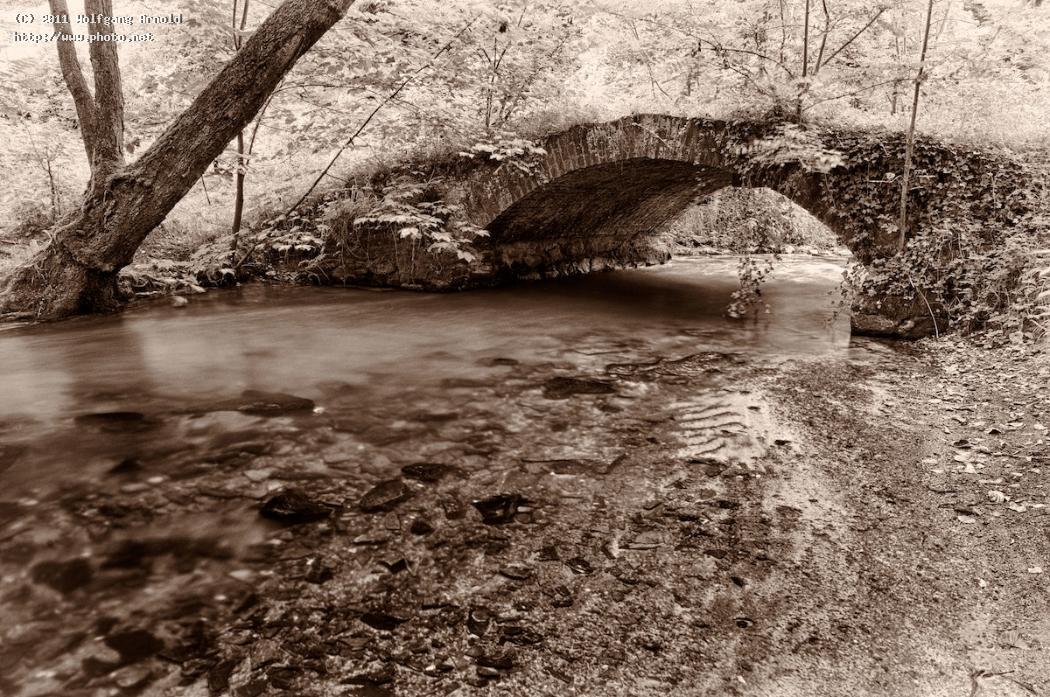 by the creek tree brick bridge trunk sepia exposure time water arnold wolfgang