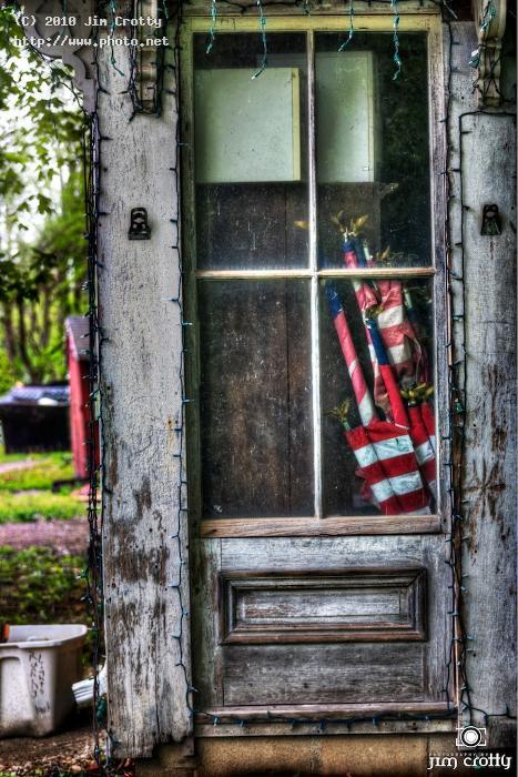 flags in old doorway rural neglect ohio jim crotty dayton photograp