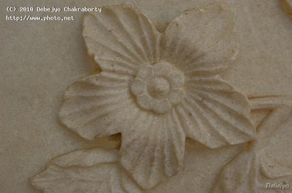 flower carved in the white marble of taj mahal chakraborty debejyo
