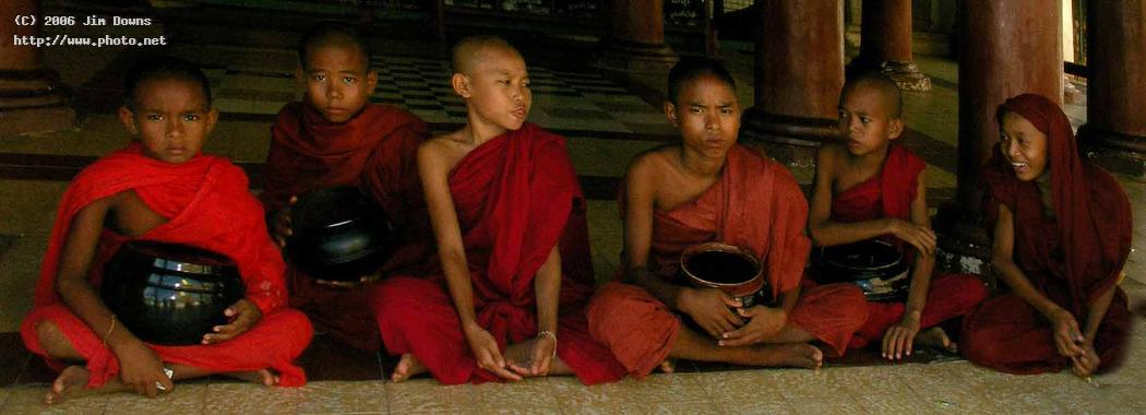 mini monks with their beggar bowls in the recesses burma myanmar seeking critique downs jim