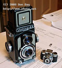mycro camera next to x tlr miniature day don
