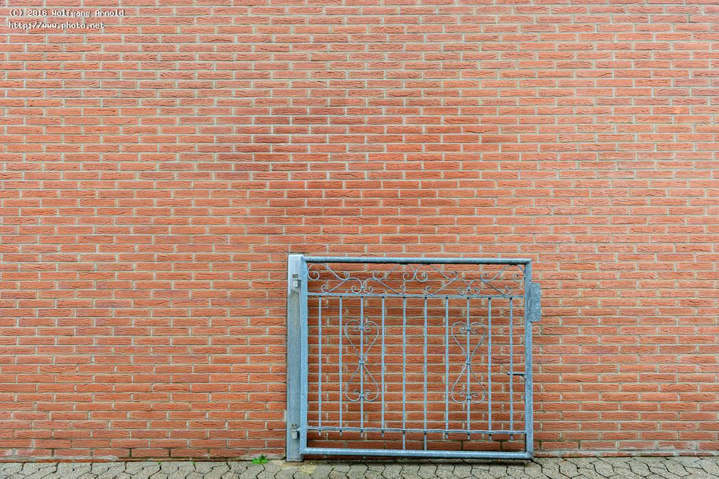 open gate brick closed wall seeking critique arnold wolfgang
