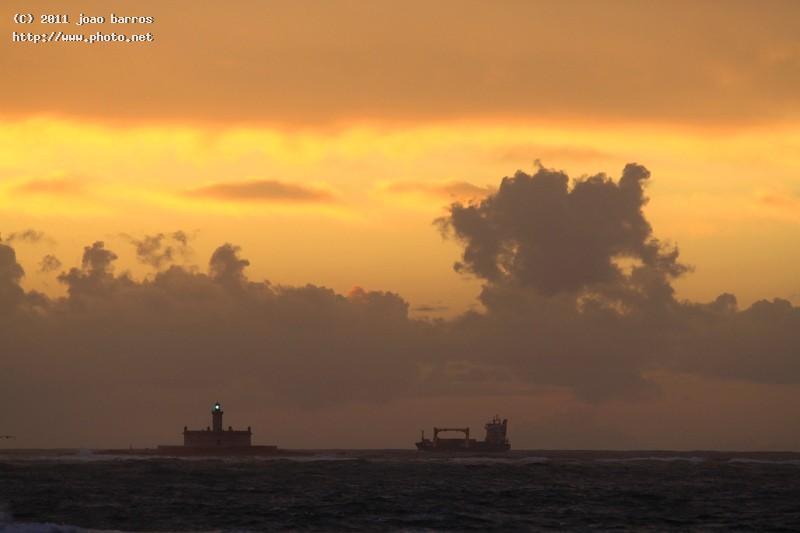 sunset in bugio lisboa beacon maritime clouds barros joao